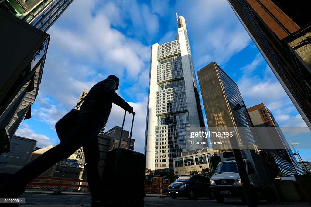 People walk past the corporate headquarters of Deutsche Bank on October 5, 2016 in Frankfurt, Germany. Banks across Europe are struggling as their profits have fallen amid an ongoing period of low interest rates, and many, including Commerzbank and Deutsche Bank of Germany, ING and ABN Amro of Holland, and Banco Popular of Spain, are responding by slashing thousands of jobs in an effort to cut costs.