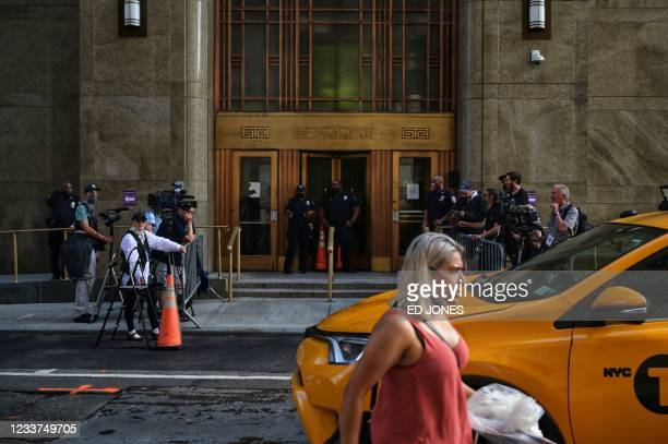 People walk past the Criminal Courts building and District Attorneys office in Manhattan,where long-serving chief financial officer of former...