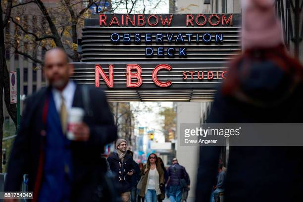 People walk past the entrance to NBC Studios November 29 2017 in New York City It was announced on Wednesday morning that long time Today Show host...