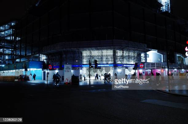 People walk past the entrance to Tottenham Court Road station at St Giles Circus in London, England, on August 14, 2020.