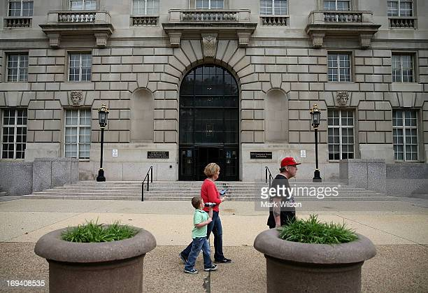 People walk past the Environmental Protection Agency building on May 24 2013 in Washington DC The EPA is one of at least four federal agencies that...