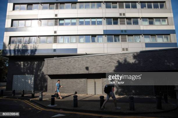 People walk past the Ferrier Point residential block in Caning Town on June 20 2017 in London England The Government has ordered councils across...