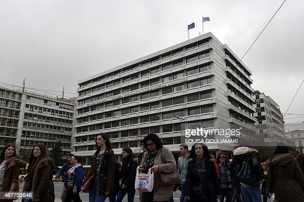 People walk past the finance ministry in Athens on march 27 2015 Bundesbank chief Jens Weidmann says he is opposed to giving Greece more emergency...