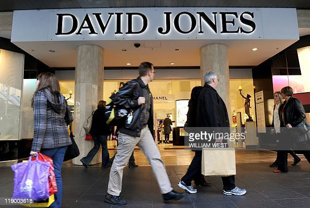 People walk past the flagship store of Australian retailing giant David Jones in Melbourne's Bourke Street Mall on July 14 2011 Shares in the...