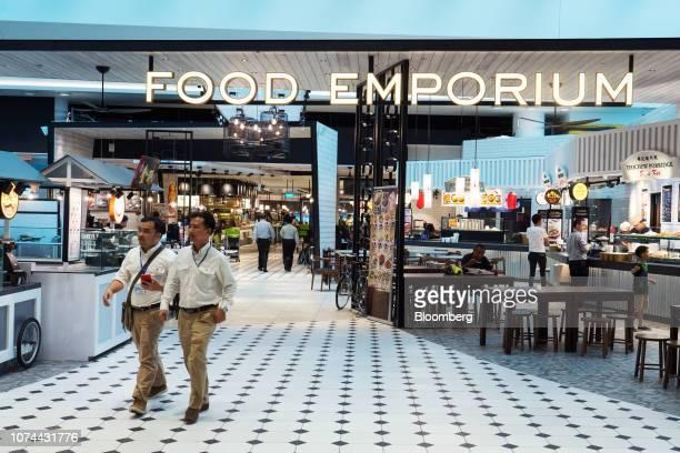 People walk past the Food Emporium at Terminal 4 of Changi Airport in Singapore on Thursday Dec 13 2018 Singapore'sChangiAirport votedtheworld's...