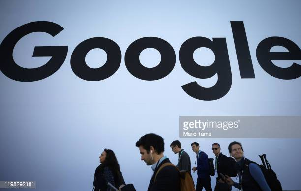 People walk past the Google pavilion at CES 2020 at the Las Vegas Convention Center on January 8, 2020 in Las Vegas, Nevada. CES, the world's largest...