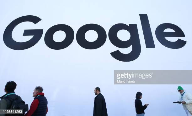 People walk past the Google pavilion at CES 2020 at the Las Vegas Convention Center on January 8 2020 in Las Vegas Nevada CES the world's largest...