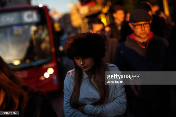 People walk past the Harrods department store as the sun goes down on November 24 2017 in London England The American actress Meghan Markle will live...
