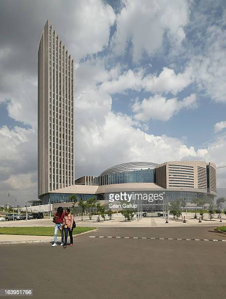 People walk past the headquarters complex of the African Union which was a gift by the government of China and completed in 2012 on March 18 2013 in...