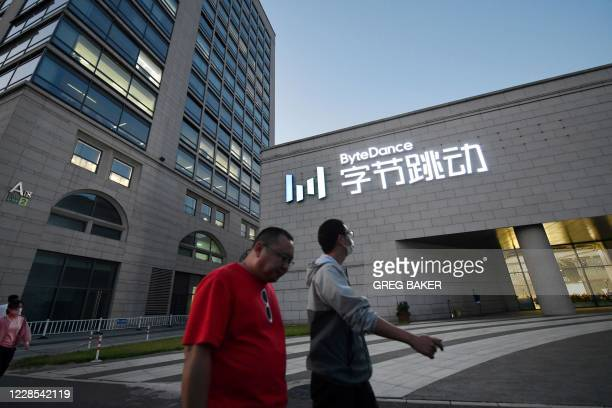 People walk past the headquarters of ByteDance, the parent company of video sharing app TikTok, in Beijing on September 16, 2020. - Silicon Valley...