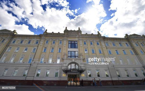 People walk past the headquarters of Russia's statecontrolled oil giant Rosneft in Moscow on June 28 2017 A wave of cyberattacks hit Russia and...