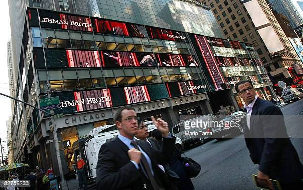 People walk past the headquarters of the investment bank Lehman Brothers in Manhattan September 10 2008 in New York City Lehman Brothers reported an...