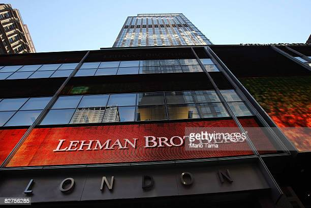 People walk past the headquarters of the investment bank, Lehman Brothers in Manhattan September 10, 2008 in New York City. Lehman Brothers reported...