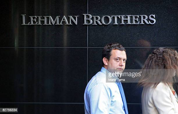 People walk past the headquarters of the investment bank, Lehman Brothers Holdings Inc. In Manhattan September 10, 2008 in New York City. Lehman...