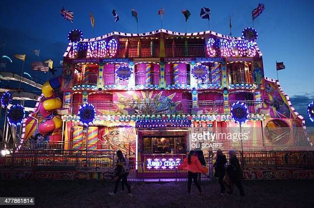 People walk past the jumbo circus at The Hoppings fun fair believed to be one of the largest travelling funfairs in Europe on its opening day in...