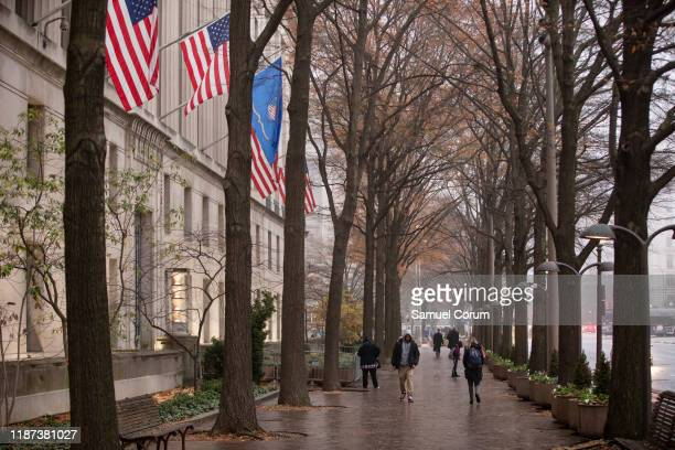 People walk past the Justice Department building on a foggy morning on December 9, 2019 in Washington, DC. It is expected that the Justice Department...