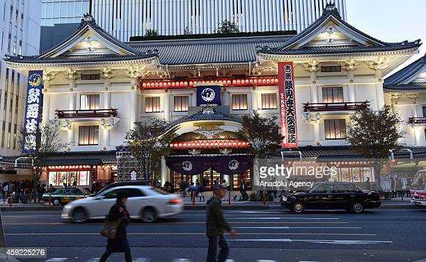 People walk past the Kabukiza theatre in Ginza district of Tokyo Japan on November 15 2014