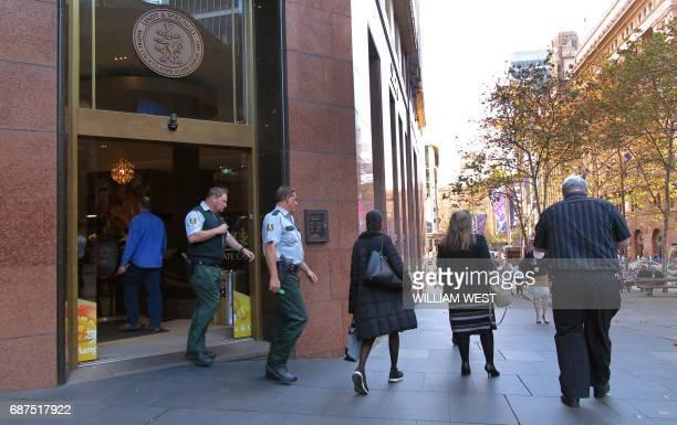 People walk past the Lindt Cafe in Sydney's Martin Place on May 24 2017 Police underestimated the threat posed by a selfstyled Islamic cleric during...