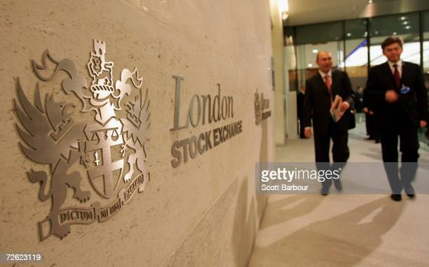 People walk past the logo of the London Stock Exchange inside of the London Stock Exchange offices on November 22 2006 in London England The London...