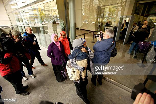 People walk past the media to enter the US Courthouse where suspected Portland car bomber Mohamed Osman Mohamud is having his first court appearance...