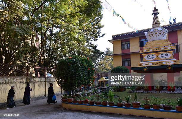 People walk past the monastery where the remains of Jigme Dorje Palbar Bista the last king of former Himalayan kingdom of Mustang is kept at Bauddha...