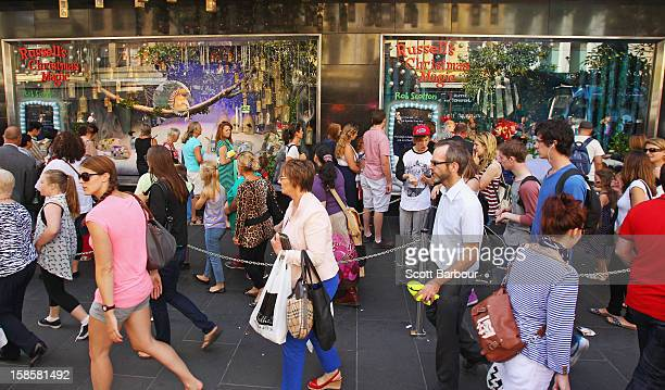 People walk past the Myer Christmas window display as they do their Christmas shopping on December 20 2012 in Melbourne Australia Australian...