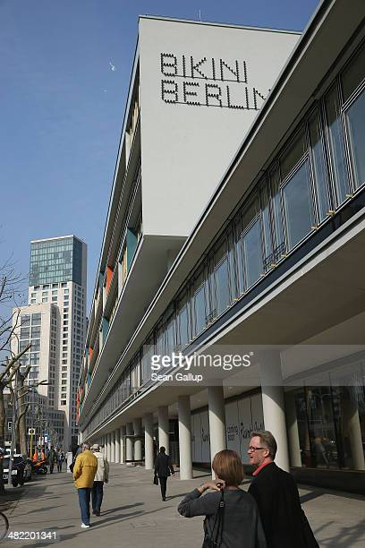 People walk past the new Bikini Berlin shopping mall on its opening day on April 3 2014 in Berlin Germany Bikini Berlin located in the Bikini Haus...