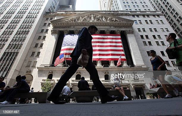 People walk past the New York Stock Exchange during afternoon trading on August 4, 2011 in New York City. The Dow dropped more than 300 points on...
