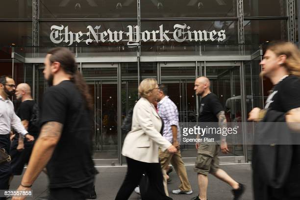 People walk past the New York Times building on July 27 2017 in New York City The New York Times Company shares have surged to a nineyear high after...
