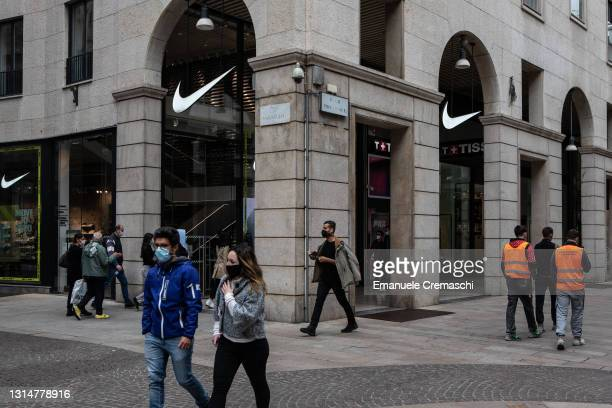 People walk past the Nike flagship store in Corso Vitttorio Emanuele II, on April 27, 2021 in Milan, Italy. Cafes, bars, restaurants, cinemas and...