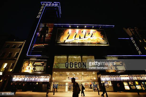 People walk past the Odeon cinema in Leicester Square May 21 2008 in London England The first public screening of Indiana Jones and the Kingdom of...