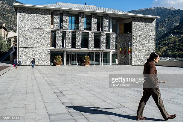 People walk past the Parliament of Andorra building on October 31 2014 in Andorra la Vella Andorra Andorra is a tax haven status although it is in...