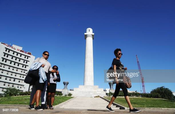 People walk past the pedestal which held Confederate General Robert E Lee's statue which was removed in 2017 amidst controversy on April 17 2018 in...