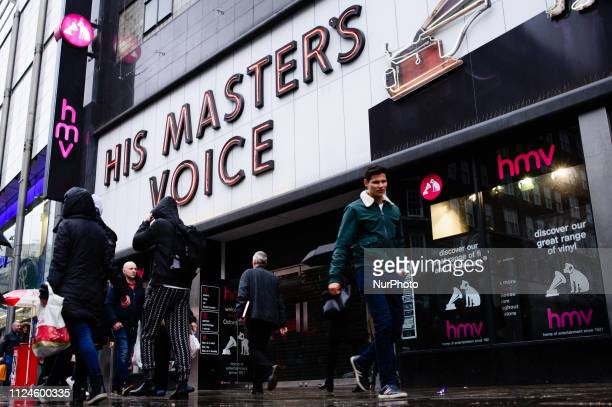 People walk past the recentlyclosed flagship branch of music and video retailer HMV on Oxford Street in London England on February 8 2019 February 15...