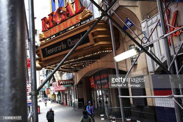 People walk past the Regal Cinemas in Times Square on March 24, 2021 in New York City. Regal Cinemas parent company, Cineworld Group, announced on...