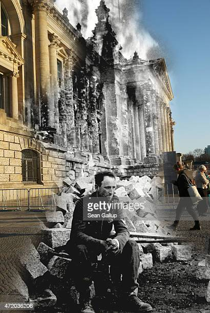 In this digital composite image a comparison has been made showing a German soldier sitting in front of the ruins of the Reichstag at the end of Worl...