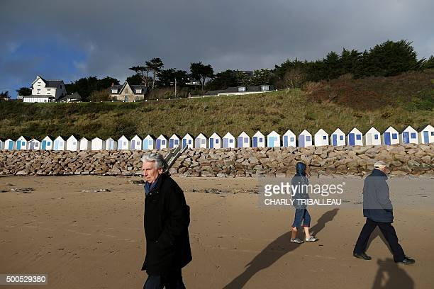 People walk past the 'riprap' shoreline defence below a cliff where a landslide occured in 2008 on the Maritime Boulevard in BarnevilleCarteret...