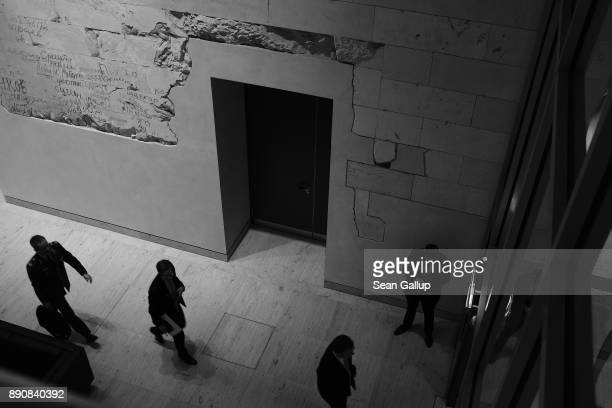 People walk past the room where German Chancellor and leader of the German Christian Democarts Angela Merkel was meeting in private with Martin...