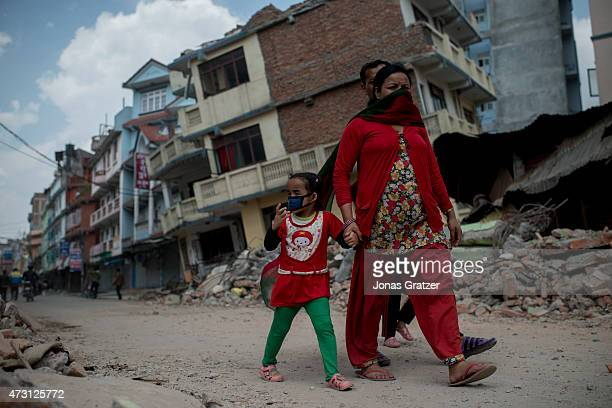 People walk past the rubble following yesterday's earthquake on May 13, 2015 in Kathmandu, Nepal. A 7.3 magnitude earthquake struck in Nepal only two...