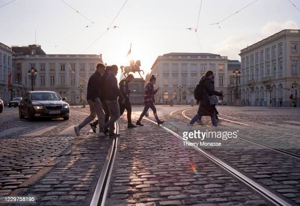 People walk past the 'Rue Royale' on November 23, 2020 in Brussels, Belgium. The country had earlier moved into a second national lockdown in an...