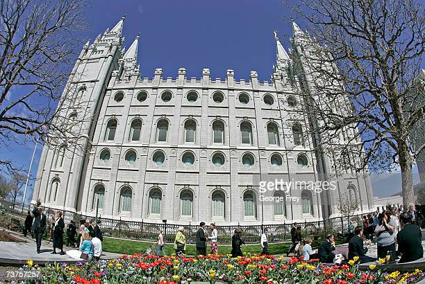 People walk past the Salt Lake Mormon Temple as Mormons gather for the 177th Annual General Conference of the Church of Jesus Christ of Latter Day...