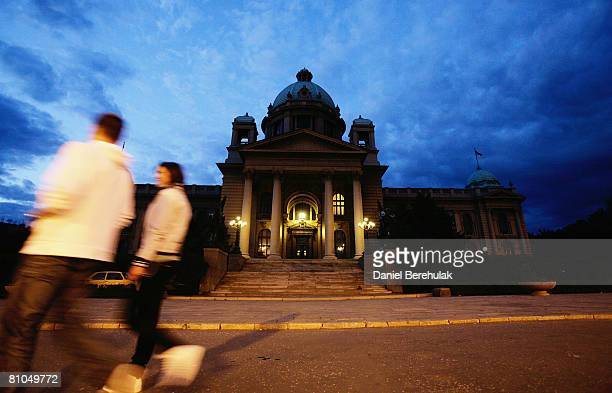 People walk past the Serbian Republic Parliament building on May 10 2008 in central Belgrade Serbia Parliamentary and local elections are to be held...