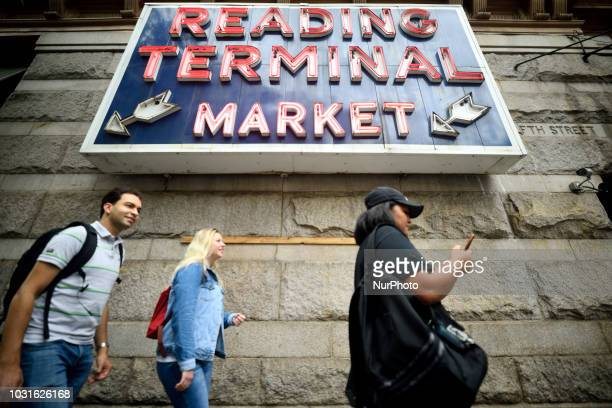 People walk past the sign of Reading Terminal market in Philadelphia PA on September 11 2018
