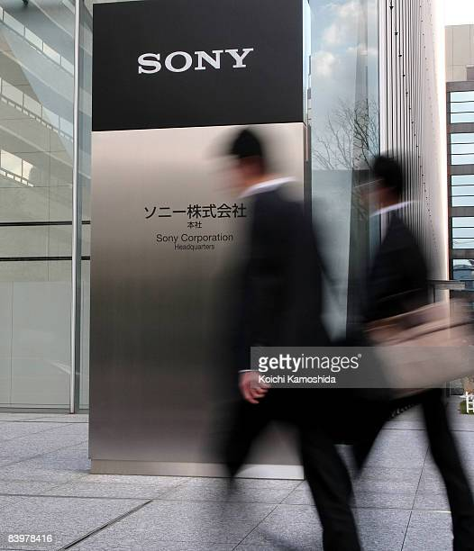 People walk past the Sony Corporation's headquarters on December 10, 2008 in Tokyo, Japan. Sony announced yesterday to slash 8,000 jobs and 8,000...