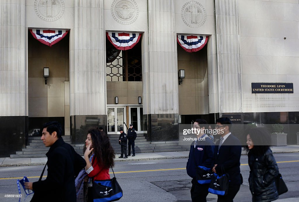 People walk past the Theodore Levin United States Courthouse November 7, 2014 in Detroit, Michigan. Today U.S. Bankruptcy Judge Steven Rhodes gave the City of Detroit the okay to plan an exit strategy from Chapter 9 Bankruptcy.