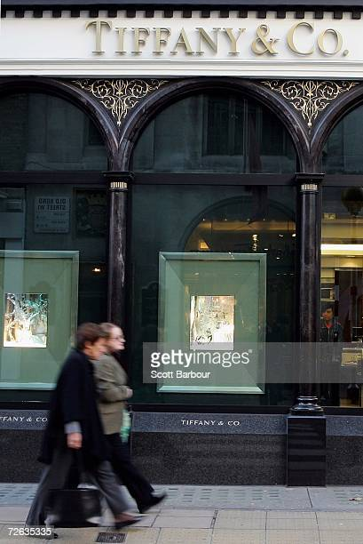 People walk past the Tiffany & Co. Store in Bond Street on November 23, 2006 in London, England. The price of Gold in London steadied in quiet trade...