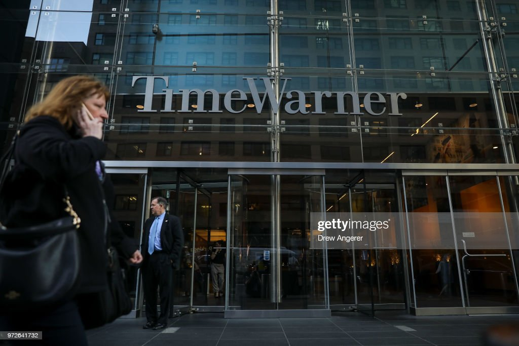 People walk past the Time Warner Center, June 12, 2018 in New York City. A federal judge today said that AT&T can move forward with its $85 billion acquisition of Time Warner, which the U.S. Justice Department had sought to block.