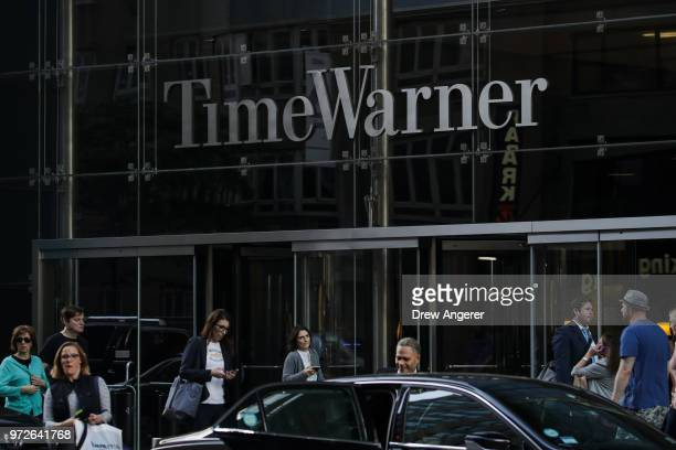 People walk past the Time Warner Center June 12 2018 in New York City A federal judge today said that ATT can move forward with its $85 billion...