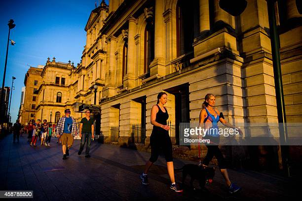 People walk past the Treasury Building in Brisbane Australia on Sunday Nov 9 2014 Prime Minister Tony Abbott will host the Group of 20 summit of...