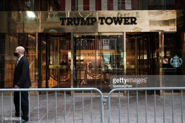 People walk past the Trump Tower as the impeachment trial of Donald Trump begins in Washington on February 09, 2021 in New York City. After listening...